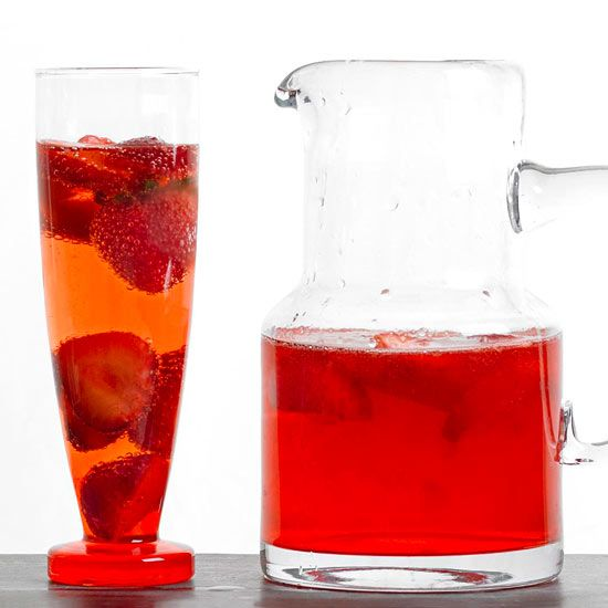 Make your party a smashing success with a cocktail recipe that packs a one-two punch of whiskey and sparkling wine. Muddled berries and a garnish of strawberry slices dress up this drink recipe for a festive occasion./