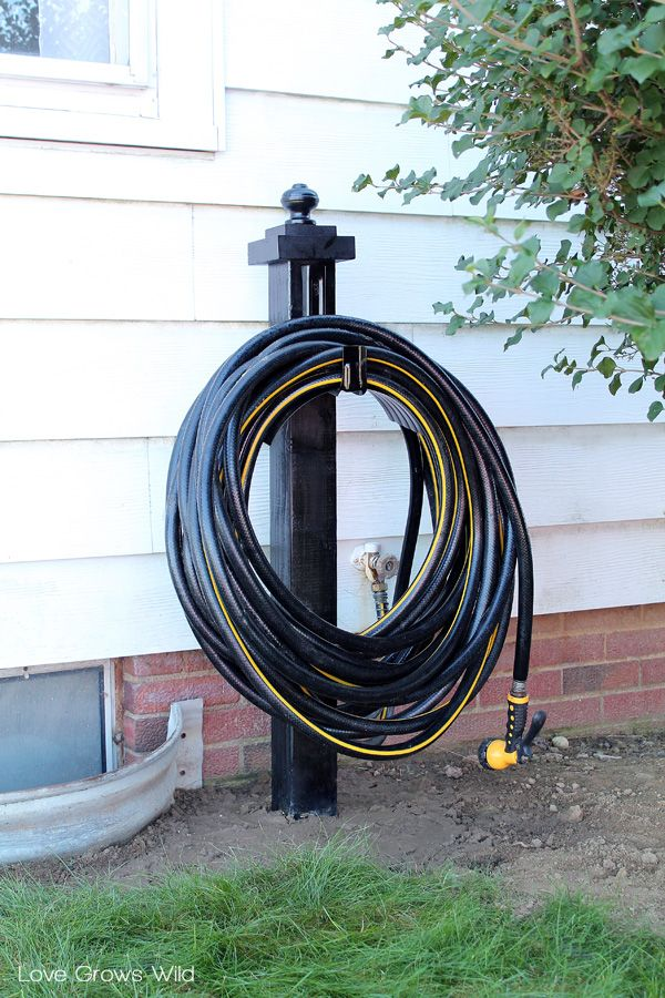 25 best ideas about hose reel on pinterest garden hose for Garden hose idea