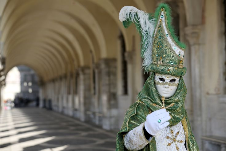 A masked reveler poses in Saint Mark square during the Carnival of Venice, a centuries-old, annual festival. The event allows Venetians to let loose in the days leading up to Lent. (Photo: Stefano Rellandini/REUTERS)