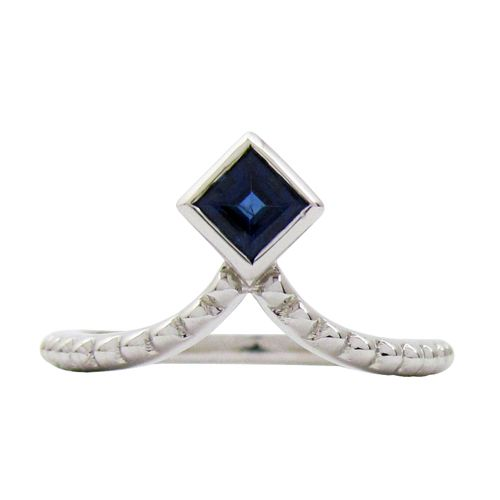 14KW BLUE SAPPHIRE TIARA RING  A 0.35TCW princess cut blue sapphire is bezel set into a 14 karat white gold Tiara ring with granulation along the shank. This blue sapphire sapphire ring is a size 6 which can also be sized. (R647)