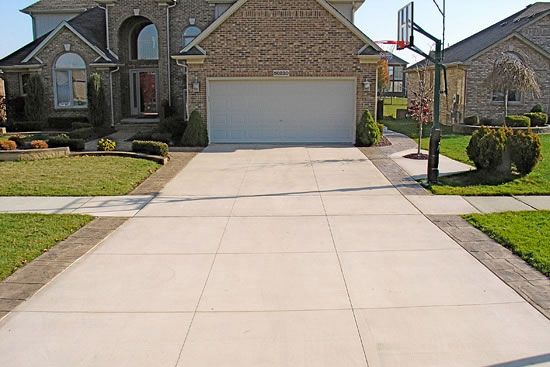 cement driveway with stamped concrete brick edge | 04-Regular-Concrete-Driveway-with-Stamped-Driveway-Borders-Macomb-MI