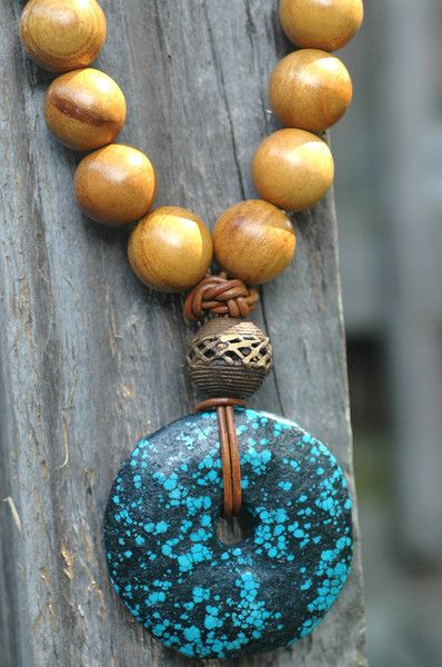 Long Wood Bead, Leather, African Brass and Turquoise Donut Pendant Necklace. Stone donuts are used to make statement necklaces with other beads or just on cord or leather.
