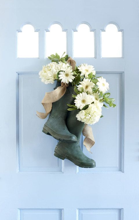 Install a metal grommet (grommet kit, $8; homedepot.com) on the back of each rain boot. Loop a piece of burlap ribbon through grommets. Place a 3-inch-wide cylindrical vase in both boot heels; stabilize with tissue paper if needed. Fill vase with water and seasonal blooms. (We used a mix of hydrangeas and daisies.) Tie ends of ribbon together and hang on a nail.