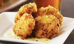 Macoroni and cheese bites, lightly fried with panko, drizzled with creamy cheese sauce. YUM!!!