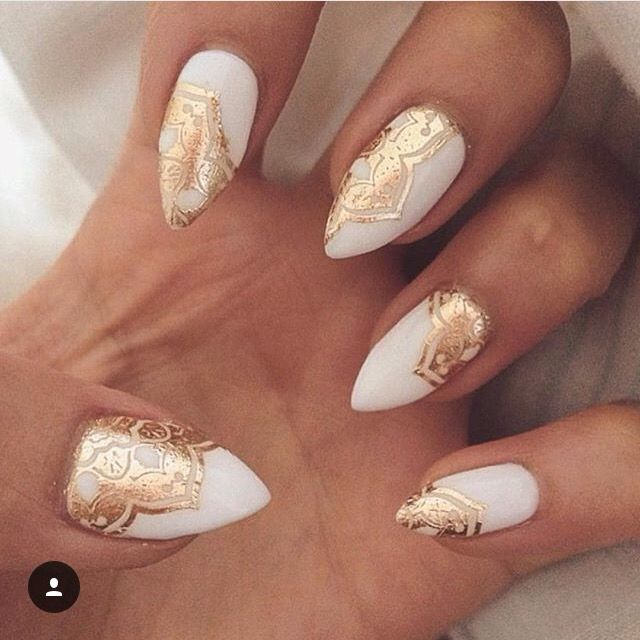 White almond acrylic nails with gold henna design