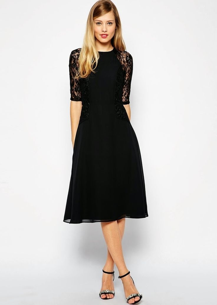 I really like this dress! It is simple yet the sleeves make it interesting. (Modest black midi below the knee dresses | Mode-sty #nolayering)