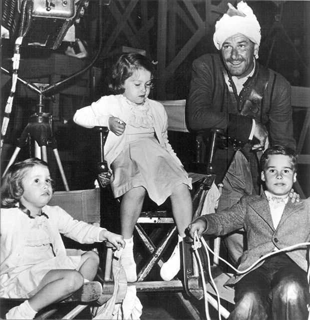"Rory, Deirdre and Sean Flynn with their father Errol Flynn on the set of ""Kim"""