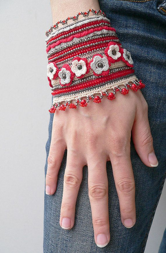 Handmade crochet bracelet with glass, metal beads, red turquoise beads in red, grey and cream colors. Decorated with crocheted grey and cream flowers.