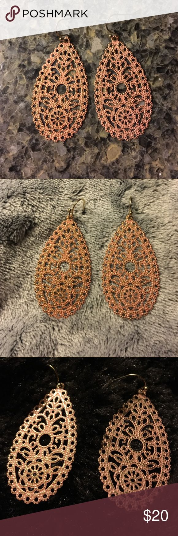 "Lovely pale orange teardrop shaped earrings NWOT These NWOT earrings are wonderfully elegant & casual at the same time. They have a vintage/lace look  & are very lightweight and comfortable to wear. The peachy/pink shade looks coppery in certain light.  They measure a tad over 1.75""L from top of the painted body to the bottom. Back is gold tone (see last picture). They are approx 1"" in diameter at the widest point. Wear them any season.  You'll look amazing! Jewelry Earrings"