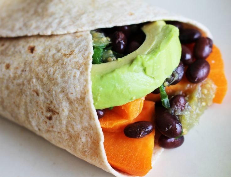 ... of a burrito filled with avocado, black bean,s and sweet potato More