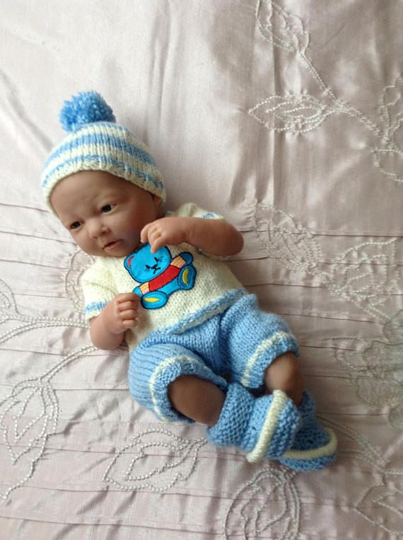 Hand knitted dolls clothes to fit a 14/15 doll/reborn