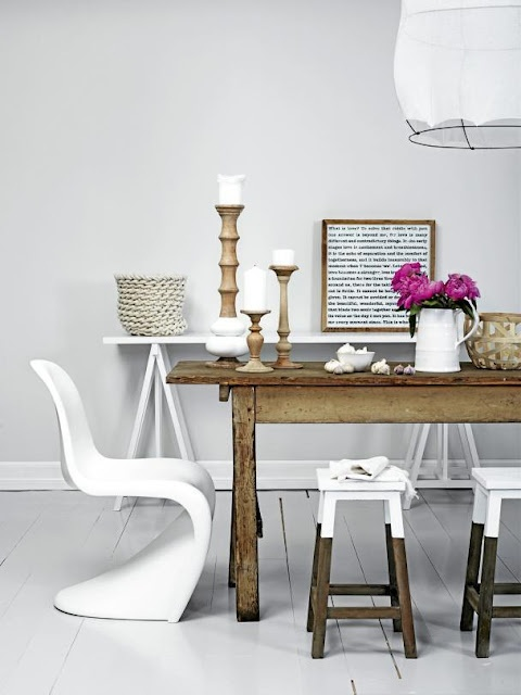 Love the paint dipped stools with the white modern chairs.