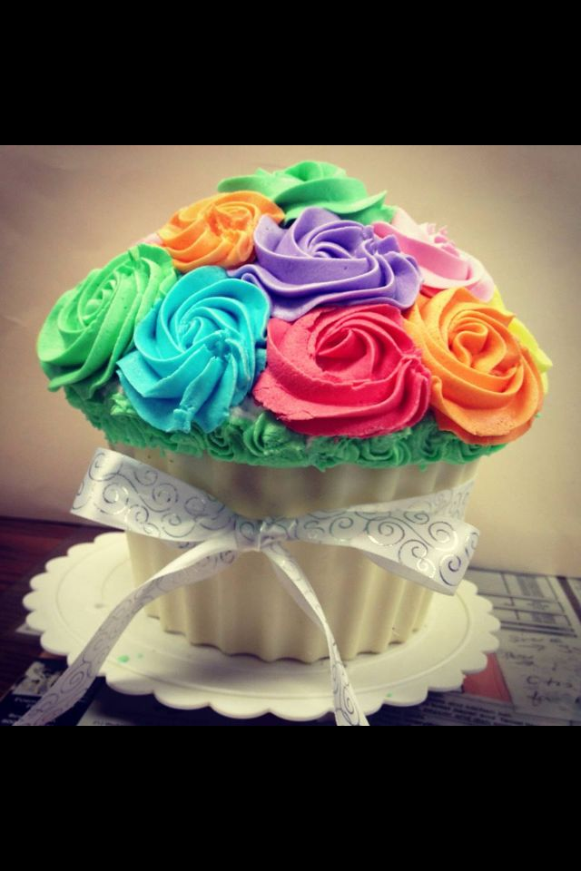 Giant cupcake, with rainbow rosettes, and cupcake liner made of Ghirardelli white chocolate -Nikki Rood