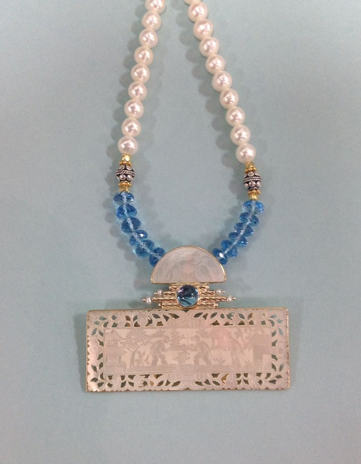 Magnificent Best Seller at JCK Las Vegas 2014 jewelry show.  Trapeze type necklace 14k and Gambling Chip Neck with highlights of blue topaz. By Donna Chambers