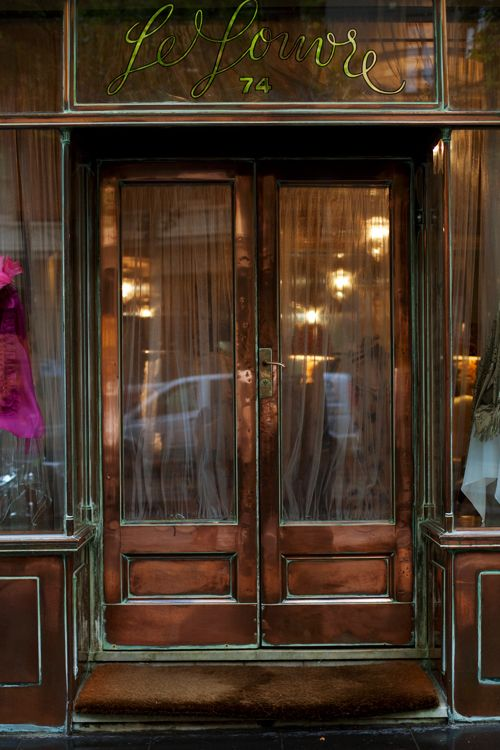"""Copper doors in Collins St Melbourne's """"Paris end"""" Was once an exclusive boutique selling the best of European fashion for 70 years.  Last year this site became a Scotch & Soda Store. What a waste."""