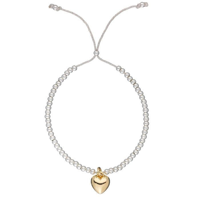 New design from the Estella Bartlett, treat yourself today to this beautifulEstella Bartlett Liberty Silver Plated Gold Heart Grey Cord Bracelet from Estella Bartlett Jewellery. Featuring a gold plated heart charm on a silver grey cord with tiny silver plated beads.