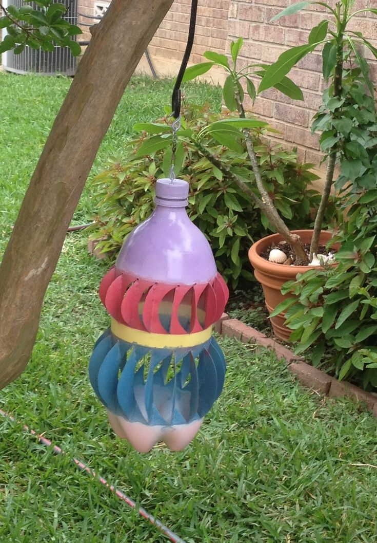 Make a wind spinner from a Soda Bottle to hang in a tree or porch for decoration. You can add bling too to keep the birds aways. They don't like the shiny reflective light.
