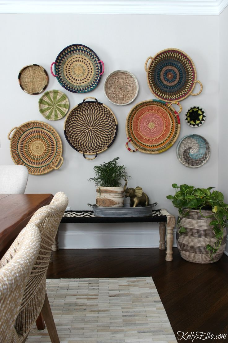 Basket Gallery Wall - love this colorful, eclectic, hand woven African basket wall and her unique way to hang them! kellyelko.com