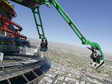 """Insanity the Ride is basically a """"massive mechanical arm extending out 64 feet over the edge of the Stratosphere Tower at a height of over 900 feet, this Vegas ride will spin you and several other passengers in the open air at speeds of up to three 'G's."""""""