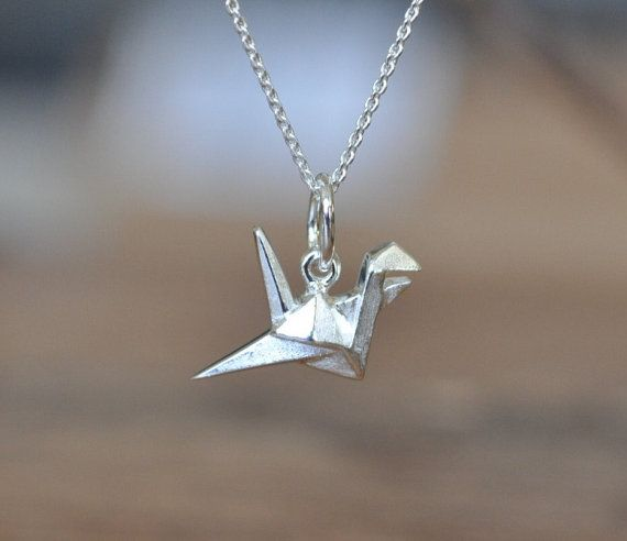 Super super adorable cute little Origami Crane Necklace! You wont be disappointed...love love this piece. ➽✤➽ Crane measures 19mm x 14mm ➽✤➽ Made from solid Sterling Silver with a Matte Finish ➽✤➽ Pendant is stamped JJ 925 - Jamber Jewels All chains are Sterling Silver 925 ➽✤➽ For the matching Crane Stud Earrings, please click here: https://www.etsy.com/listing/215320558/sterling-silver-origami-crane-stud?ref=shop_home_active_2&ga_search_query=crane Thank You