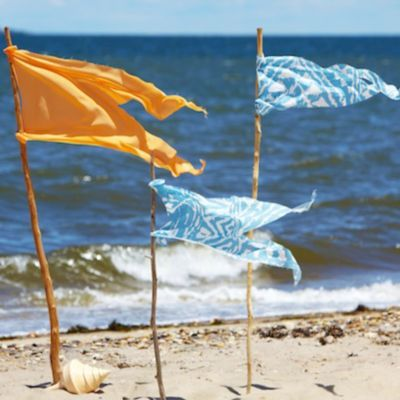 Check out our easy how to for creating fabric beach flags, perfect for the beach!   https://www.onekingslane.com/live-love-home/2012/07/beach-flag-markers/#