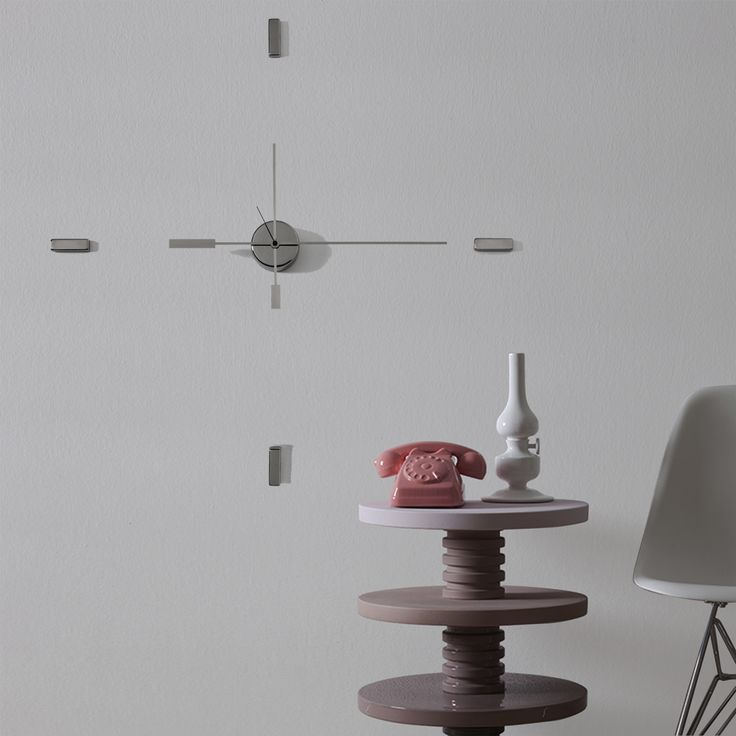Amuro is a minimalist and elegant wall clock. With its essential form, is characterized by long, slender hands that creates intriguing shadow play, almost a re-enactment of the ancestor sundial. Consisting of only 4 blocks and 1 small cylinder containing the gears, it is easily attached to the wall with a simple tack for the center and double-sided tape for hours. available only on http://www.bosatrade.com/en/Products#filter=*