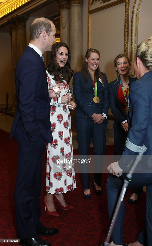 Britain's Prince William, Duke of Cambridge, (L) and Britain's Catherine, Duchess of Cambridge, meet athletes during a reception for Team GB's Olympic and Paralympic athletes, hosted by Britain's Queen Elizabeth II, at Buckingham Palace in central London on October 18, 2016. Britain's stars of this year's Olympic and Paralympic Games in Rio attended an 'amazing' reception at Buckingham Palace -- the official London home of Queen Elizabeth II -- on Tuesday. / AFP / POOL / Yui Mok