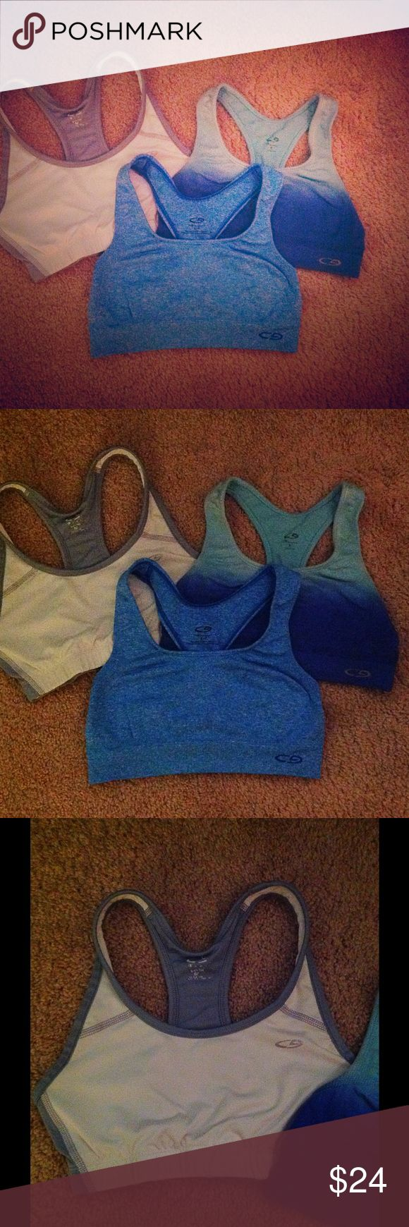 Sports bra bundle! Three Champion sports bras. White with gray border, solid blue and dark blue/light blue. All are size S with light wear. All stretchy! Willing to sell separately! Comment below Champion Intimates & Sleepwear Bras
