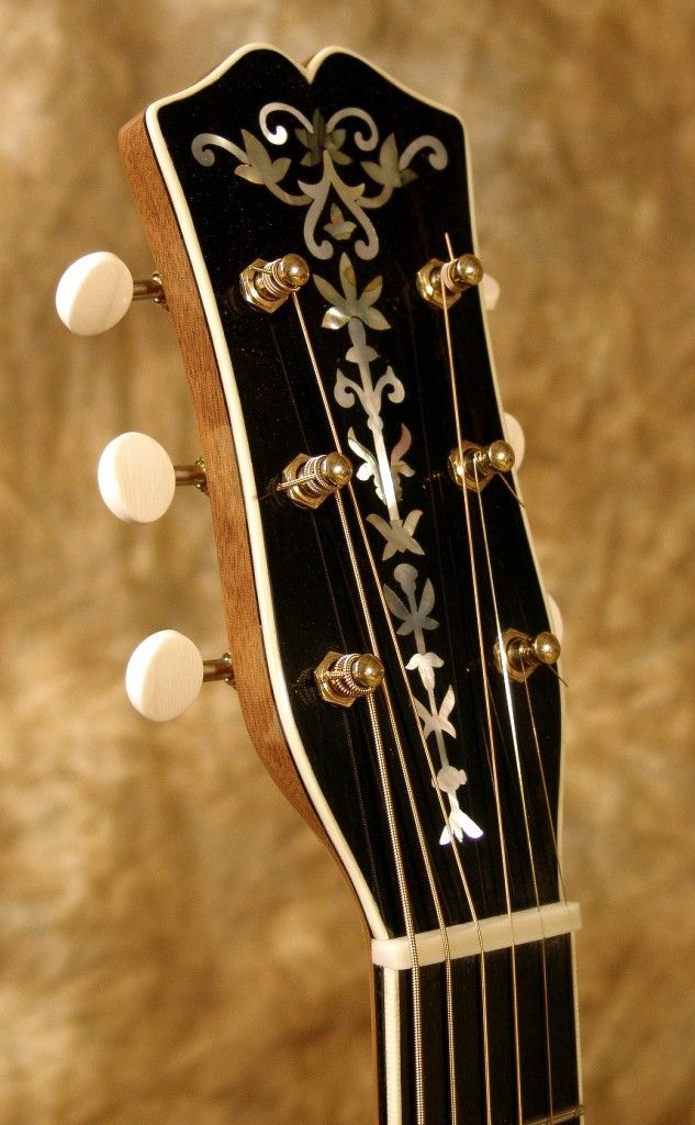 Lovely headstock from a New Era custom. This is the 'model' for the Guitarbench Magazine's Knowledge article for Issue 3 on headstocks.... more info here: http://www.guitarbench.com/2012/09/17/the-knowledge-headstock/
