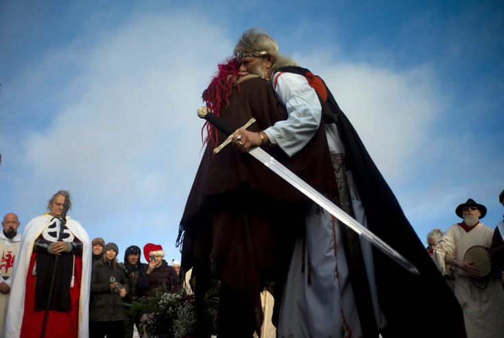 . Druid Arthur Pendragon hugs a reveller during the winter solstice at Stonehenge on Salisbury plain in southern England December 21, 2012. The winter solstice is the shortest day of the year, and the longest night of the year. REUTERS/Kieran Doherty