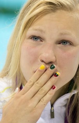 Ruta Meilutyte of Lithuania with her national flag painted on her nails blows a kiss to the crowd at the Aquatics centre after winning the women's 100m breaststroke of the 2012 Olympic Games in London on July 30, 2012. AFP PHOTO / ODD ANDERSENODD ANDERSEN/AFP/GettyImages Photo: Odd Andersen, AFP/Getty Images / SF