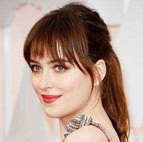 Oscars 2015 Best Looks - Dakota Johnson - Loose Fringe Ponytail http://hairello.com/blog/best-looks-from-the-oscars-2015/