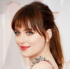Oscars 2015 Best Looks - Dakota Johnson - Loose Fringe Ponytail http://hairello.com/blog/best-looks-from-the-oscars-2015/