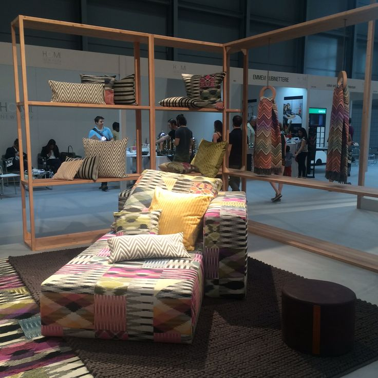 Spotlight on a MissoniHome chaise lounge in Patch Di Fiammati, with pillows and throws from the collection behind.