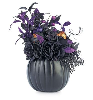 Halloween Centerpiece Craft Pumpkin  There's no end to what you can do with a craft pumpkin! Explore your possibilities, whether you like cute or creepy, and create the perfect Halloween décor sure to bring squeals of frightful delight to young and old alike!    Designed by Jessica Walker
