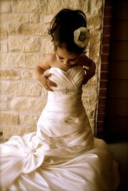 Get a picture of your little girl in your wedding dress.  Such a cute idea if we have a little girl one day!