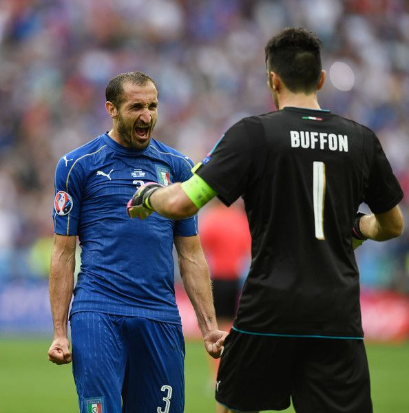 Giorgio Chiellini (L) and Gianluigi Buffon (R) of Italy celebrate their team's 2-0 win in the UEFA EURO 2016 round of 16 match between Italy and Spain at Stade de France on June 27, 2016 in Paris, France.
