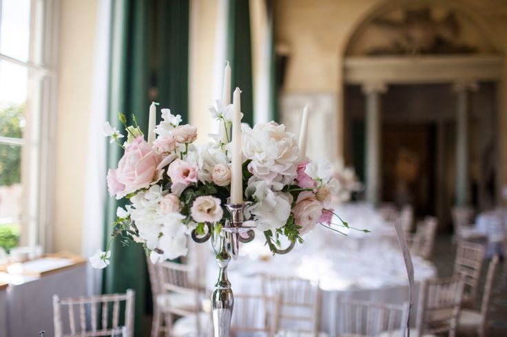 Romantic and elegant candelabra design created by Wild Orchid at Woburn sculpture gallery.  Roses, lisianthus, sweet pa, hydrangea