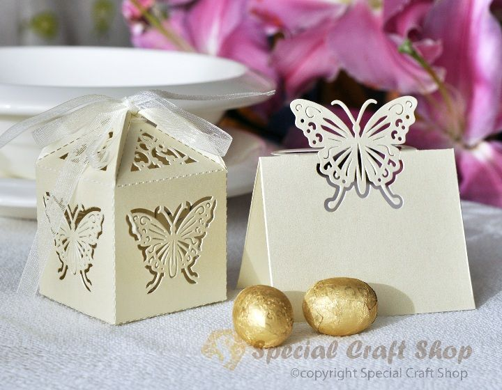 make box with star cut design & make top as the tent card (that opens to add flameless candle inside) to use as place card