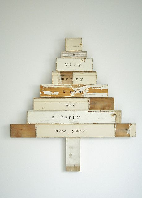 white painted wood Christmas tree with text