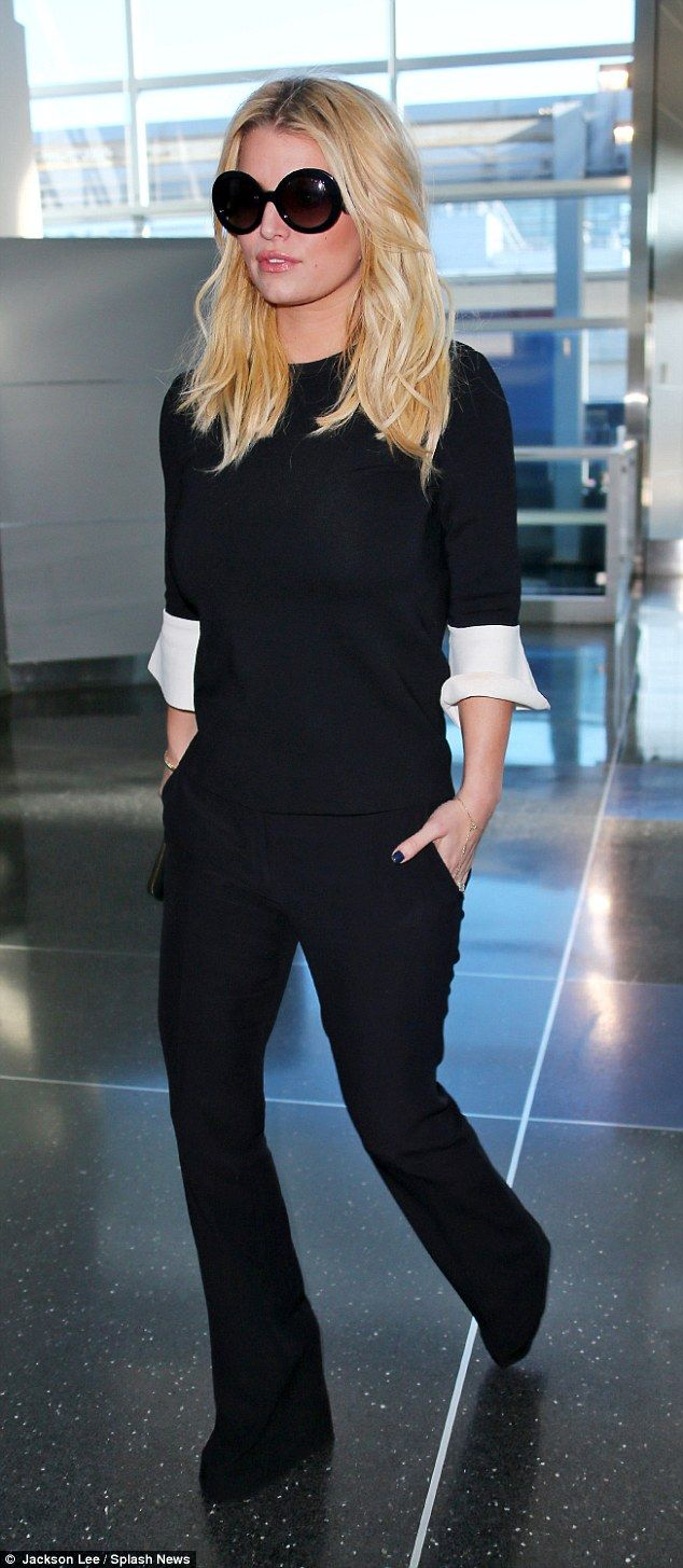 Airport style: Jessica Simpson looked gorgeous in a chic black and white ensemble as she headed through JFK airport in New York on January 13, 2016