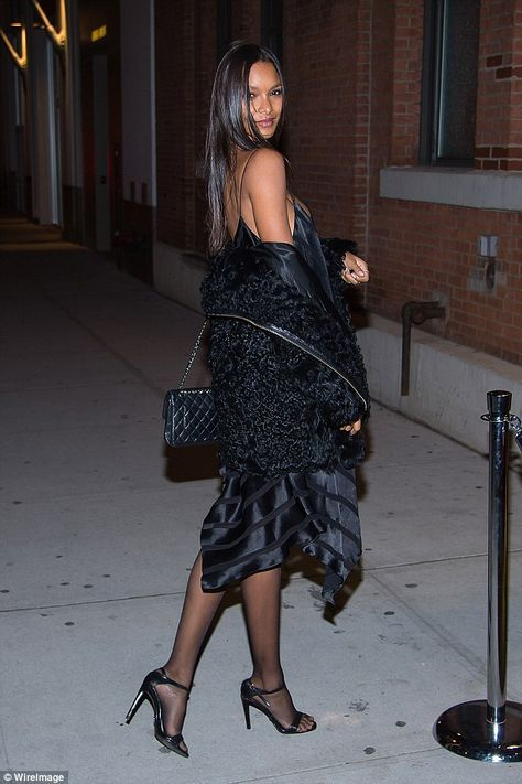 Saucy: Lais Ribeiro, a Brazilian stunner, looked slinky in a black mini ...