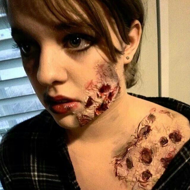 Zombie makeup using costume blood, foundation, white glue, tissue paper, and assorted eyeshadow