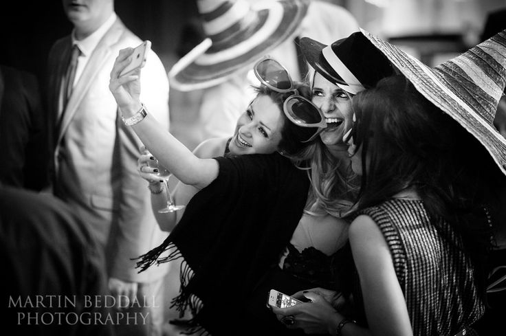 attractive female wedding guests pose for a selfie