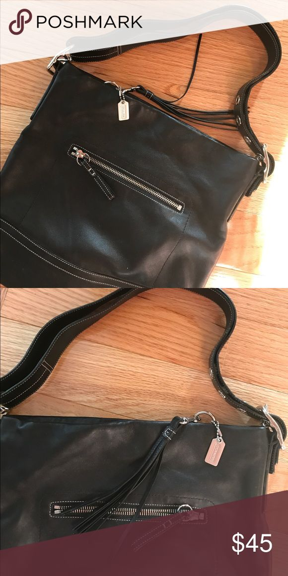 Black leather Coach pocketbook Soft black leather Coach bag with lots of pockets. Only used once. Coach Bags Shoulder Bags
