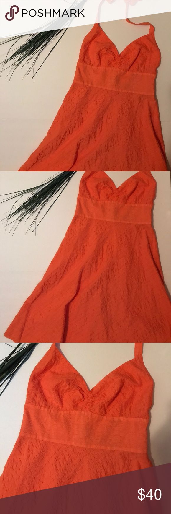 "J. Crew Halter Embossed Orange Beach Dress Beautiful J. Crew Halter orange/peach colored dress. 36"" long and 11 & 1/2"" under the bust. Halter strap is adjustable and it zips up the back. Material is 100% Cotton J. Crew Dresses Midi"