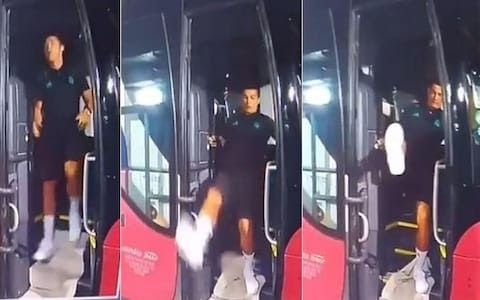 Cristiano Ronaldo loses his footing trying to exit the Real Madrid busCREDIT:REAL MADRID TV  Real Madrid are in Macedonia to play Jose Mourinho's Manchester United in the Uefa Super Cup.  Ronaldo is expected to start against his former club after returning to Real Madrid training after being granted an extended summer break due to his participation in the Confederations Cup.  But the 34-year-old was almost ruled out of the game completely when he trod on a loose piece of carpet placed on the…