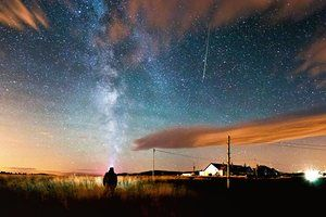The annual Perseid meteor shower as seen from Bamburgh in Northumberland, England.