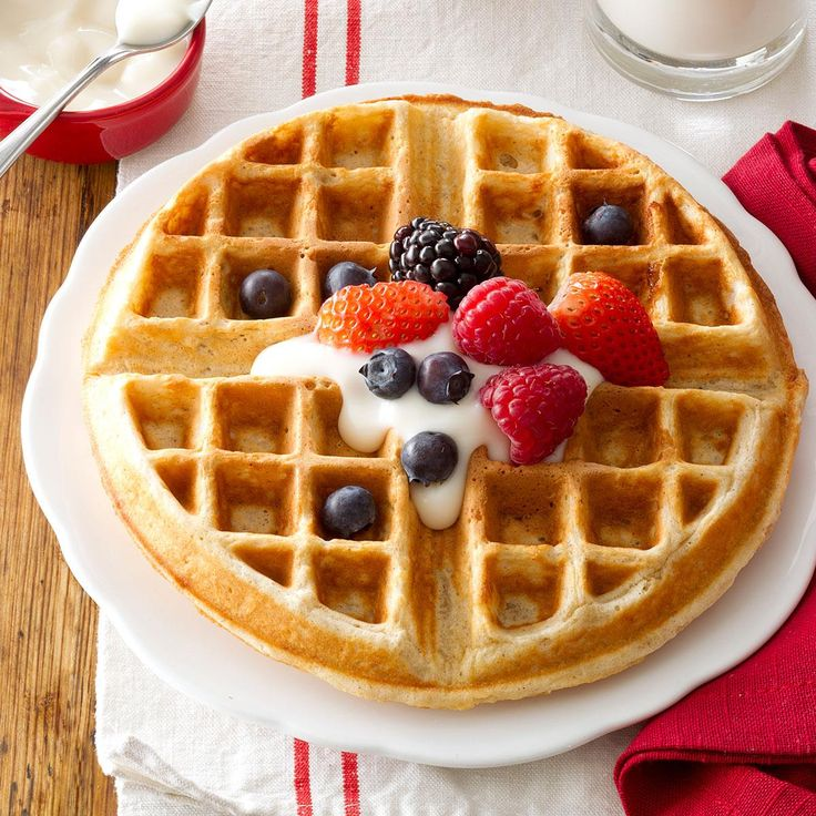Family-Favorite Oatmeal Waffles Recipe -These healthful, good-tasting waffles are a tried-and-true family favorite—even with our two children. My husband and I have a small herd of beef cattle and some pigs. A hearty breakfast really gets us going! —Marna Heitz, Farley, Iowa