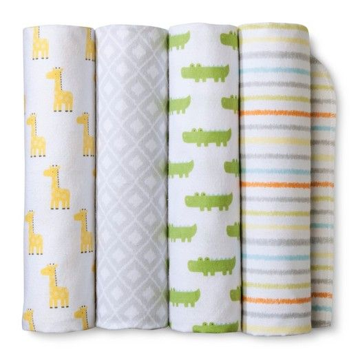 Cuddle baby close for feedings or bedtime stories with the Snooz'n Safari Yellow Flannel Baby Blankets from Cloud Island™. Made of soft, brushed cotton, you and baby will both love the feel of these blankets. While baby will be snug as a bug when wrapped up in these cozy blankies, the pack of four gives you the option to mix and match for different uses — bright yellow giraffes or green alligators for a cute car seat cover, neutral gray diamonds for a discreet nursing c...